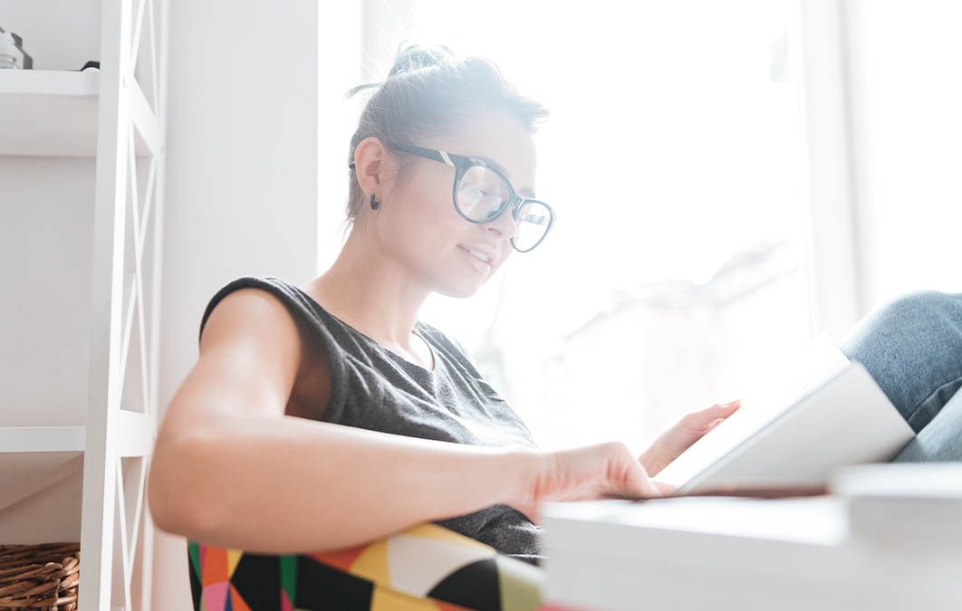 woman reading about investing